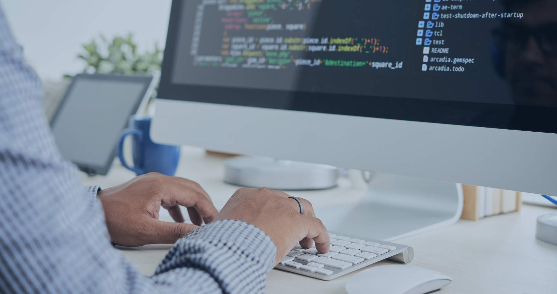 Cropped image of It specialist working on code